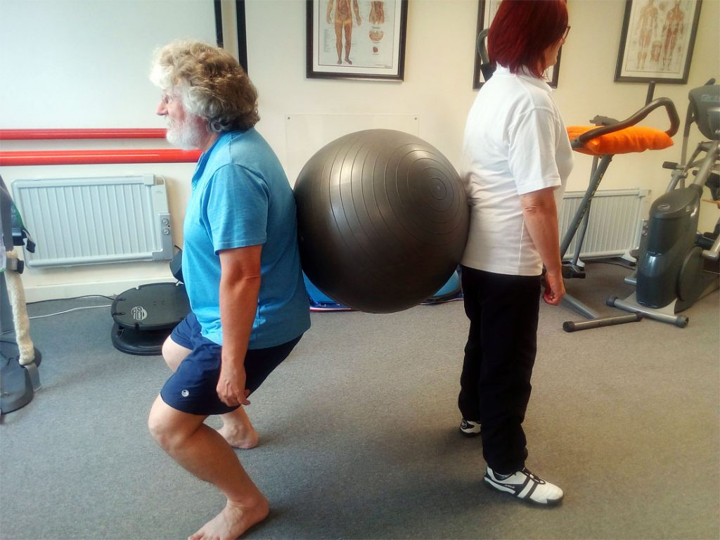 therapyroom1 picture of a therapist and patient doing to teamwork rehab exercise