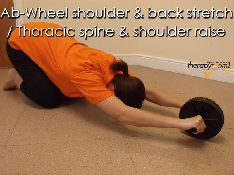 a therapyroom1 patient performing an ab-wheel rehabilitation exercise for upper back and posterior shoulder injuries